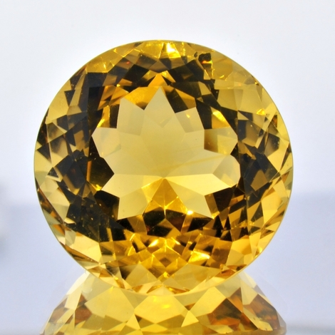 Citrine round golden yellow 75.22 ct