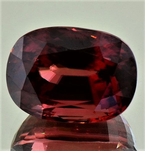 Zircon cushion reddish 40.24 ct
