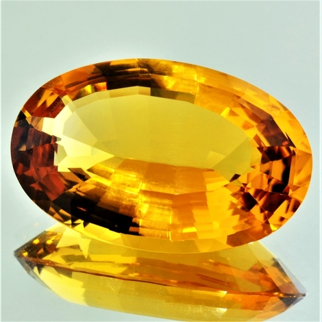 Citrine oval yellowish-orange 68.73 ct