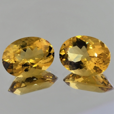 Citrine Pair oval golden yellow 26.49 ct