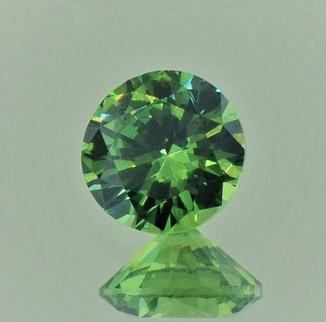Demantoid Granat rund-brillantiert 1,21 ct