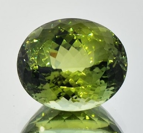 Tourmaline oval yellowish green 30.48 ct