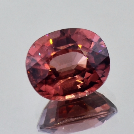 Zircon oval orangy pink (slightly brownish) 14.14 ct